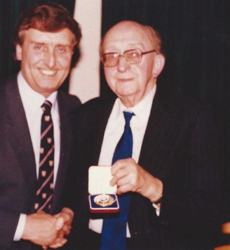 Derek with Award